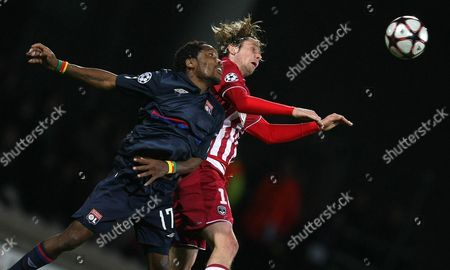 Jean II Makoun, Jaroslav Plasil Lyon's Jean II Makoun of Cameroon jumps for the ball with Bordeaux's Jaroslav Plasil of Czech Republic during their Champions League quarterfinal first leg soccer match, in Lyon stadium, central France