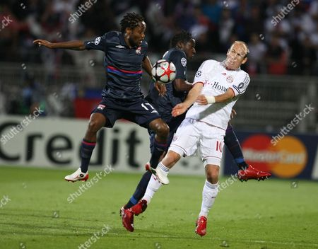 Jean II Makoun, Aly Cissokho, Arjen Robben Lyon's Jean II Makoun of Cameroon, left, and Aly Cissokho of France, center, fight for the ball with Bayern Munich's Arjen Robben of Netherlands during their Champions League semifinal second leg soccer match between Lyon and Bayern Munich, in Lyon stadium, central France