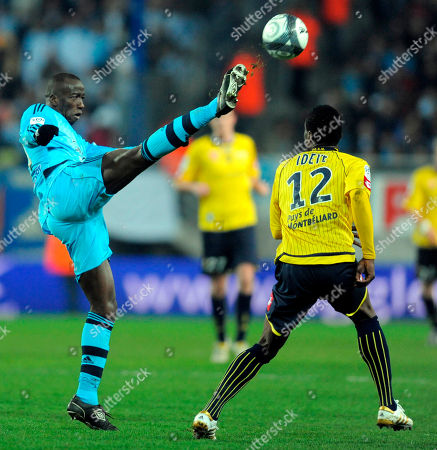 Marseille's Souleymane Diawara, left, challenges for the ball with Sochaux's Aide Brown Ideye during their French League One soccer match at the Bonal Stadium in Sochaux, eastern France
