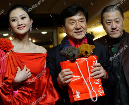 Peng Lin, Jackie Chan, Ding Sheng Actors Peng Lin, Jackie Chan holding official Berlinale toy bears and director Ding Sheng arrive for the premiere of the film 'Little Big Soldier' during the International Film Festival Berlinale in Berlin, Germany