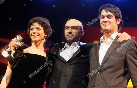 Florin Serban,Ada Condeescu, George Pistereanu Romanian director Florin Serban, center and actors Ada Condeescu, left, and George Pistereanu of the movie 'If I Want To Whistle, I Whistle' react after awarding with the Silver Bear Bear at the International Film Festival Berlinale in Berlin, Germany