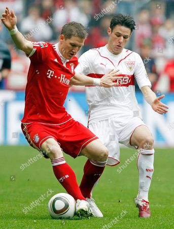 Sebastian Schweinsteiger, Christian Traesch Munich's Bastian Schweinsteiger, left, and Stuttgart's Christian Traesch challenge for the ball during the German first division Bundesliga soccer match between FC Bayern Munich and VfB Stuttgart in Munich, Germany, on