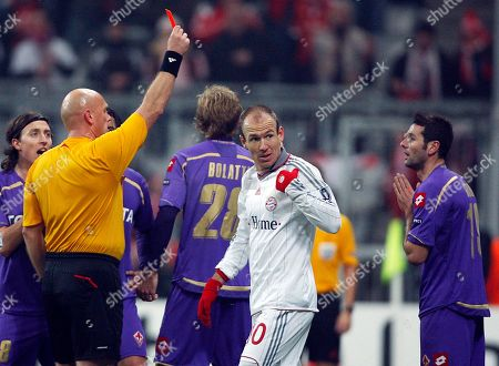 Massimo Gobbi, Tom Henning Ovrebo Fiorentina's Massimo Gobbi, right, receives the red card by referee Tom Henning Ovrebo, left, during the Champions League round of the last sixteen first leg soccer match between Bayern Munich and ACF Fiorentina in Munich, Germany