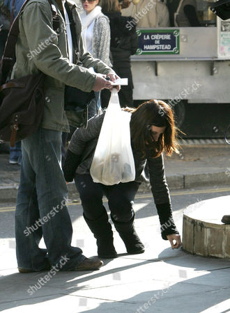 Jayne Middlemiss picking up change from the ground
