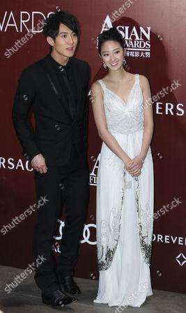 Nicholas Tse, Guey Lun-mei Brunei-born Chinese actor Wu Chun, left and Taiwan actress Guey Lun-mei pose on the red carpet of the Asian Film Awards at Hong Kong International Film Festival in Hong Kong