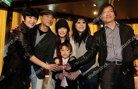 """Alex Law, Mabel Cheung, Simon Yam, Sandra Ng, Evelyn Choi, Buzz Chung From right, Hong Kong film director Alex Law, producer Mabel Cheung, actress Evelyn Choi, actor Simon Yam, actress Sandra Ng and young actor Buzz Chung, front, pose with the Berlin International Film Festival Crystal Bear prize for their movie """"Echoes of a Rainbow"""" during a press conference in Hong Kong . Hong Kong on Monday celebrated a rare foreign film prize for a low-budget family drama set in the 1960s, a triumph viewed as a huge moral boost for a struggling industry overshadowed by the booming Chinese market"""