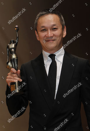 "Teddy Chen Hong Kong director Teddy Chen celebrates after winning the best director of his movie ""Bodyguards And Assassins"" at the Hong Kong Film Awards in Hong Kong"