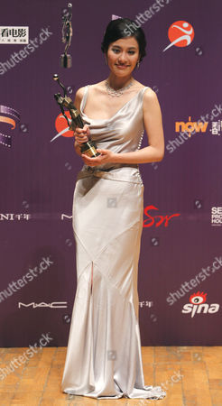 """Stock Picture of Michelle Ye Hong Kong actress Michelle Ye poses with her trophy after winning the best actress of her movie """"Accident"""" at the Hong Kong Film Awards in Hong Kong"""