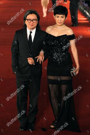 Peter Chan, Sandra Ng Hong Kong director Peter Chan, left and his wife Hong Kong actress Sandra Ng pose on the red carpet of the Hong Kong Film Awards in Hong Kong