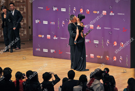 "Teddy Chen, Wai Yin Hung Hong Kong director Teddy Chen, left and Hong Kong actress Wai Yin Hung celebrate after winning the best director and the best actress for their movie ""Bodyguards And Assassins"" and ""At The End Of Daybreak"" at the Hong Kong Film Awards in Hong Kong"