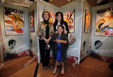 Linda Cadwell, Shannon Lee, Wren Keasler Linda Cadwell, widow of the late kung fu star Bruce Lee, left, Lee's daughter Shannon Lee, right and Shannon's daughter Wren Keasler attend opening ceremony for Bruce Lee's exhibition as part of the event at the Hong Kong International Film Festival in Hong Kong . Bruce Lee's wife and daughter on Tuesday unveiled an exhibition of the late kung fu star's personal items, photos and movie posters in Hong Kong to mark what would have been his 70th birthday this November. The exhibit, which includes a boxing head guard and a pair of sunglasses used by Lee, is part of a tribute to the late actor at the 34th Hong Kong