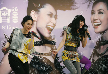 """Gillian Chung, Charlene Choi Members of the music group """"Twins,"""" Hong Kong actress-singer Gillian Chung, left, and Charlene Choi perform during a news conference for their upcoming concerts in Hong Kong . Chung on Wednesday announced she will reunite with her former bandmate for two concerts, as her comeback from a sex photos scandal gained momentum. Chung was one of eight Hong Kong female stars who was seen performing sex acts with Canadian-Chinese entertainer Edison Chen in nude pictures that leaked onto the Internet in 2008"""