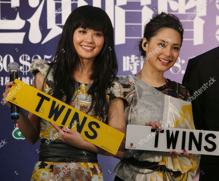 """Gillian Chung, Charlene Choi Members of the music group """"Twins,"""" Hong Kong actress-singer Gillian Chung, right, and Charlene Choi pose during a news conference for their upcoming concerts in Hong Kong . Chung on Wednesday announced she will reunite with her former bandmate for two concerts, as her comeback from a sex photos scandal gained momentum. Chung was one of eight Hong Kong female stars who was seen performing sex acts with Canadian-Chinese entertainer Edison Chen in nude pictures that leaked onto the Internet in 2008"""