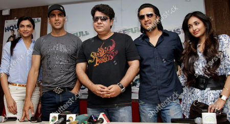 """Stock Image of Bollywood actors Deepika Padukone, left, Akshay Kumar, second from left, Riteish Deshmukh, second from right and Jiah Khan pose for photographers along with director Sajid Khan, center, during a press conference to promote their film """"Houseful"""" in Ahmadabad, India, . The film will be released on April 30"""