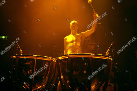 Gold painted man on drums