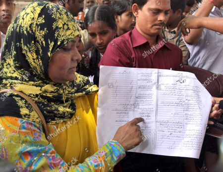 United Women Front President Shiraz Sareen Khan shows signature of Pakistan cricketer Shoaib Malik and Ayesha Siddiqui, the woman claiming to be Malik's wife, in a photocopy of the nikahnama (marriage certificate) in Hyderabad, India, . Hyderabad police have questioned Malik about Siddique and have asked him not to leave India during investigation ahead of his planned marriage to Indian tennis star Sania Mirza