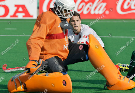 Philip Wright, Keeper Salman Akbar Canada's Philip Wright, background, waits for the ball inside Pakistan's penalty area as Pakistan's Keeper Salman Akbar takes defensive action during the International Hockey Federation (FIH) World Cup 2010 field hockey match in New Delhi, India