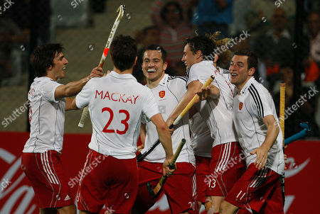 Adam Dixon, Iain Mackay, James Tindall, Rob Moore, Alastair Brogdon British players, from left to right, Adam Dixon, Iain Mackay, James Tindall, Rob Moore and Alastair Brogdon celebrate after scoring their third goal against Australia during the FIH World Cup 2010 field hockey match in New Delhi, India