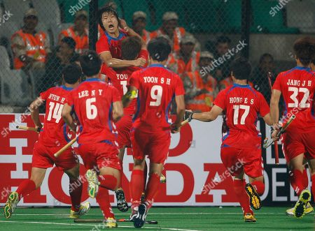 Koren players from left to right, Hyun Hye-Sung, Lee Nam-Yong, You Hyo-Sik holding up Nam Hyun-Woo, Hong Eun-Seong and Jang Jong-Hyun celebrate after they scored their winning goal, moments before the end of the match during the International Hockey Federation (FIH) World Cup 2010 field hockey match against Argentina in New Delhi, India