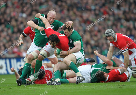 Wales' Jonathan Thomas, center, is stopped by Ireland's Paul O' Connell, left, and Cian Healy, right, during their six nations rugby union international match at Croke Park, Dublin, Ireland, Saturday, March, 13, 2010