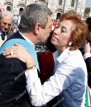 """Milan's mayor Letizia Moratti, right, kisses president of the """"Provincia"""" Guido Podesta' on the occasion of the Liberation Day, in front of Milan's gothic cathedral, Italy, . The day commemorates the liberation of Italy from Nazi occupation during WWII"""