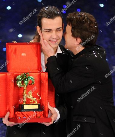 """Valerio Scanu is congratulated by Pupo after winning during the """"Festival di Sanremo"""" Italian song contest at the Ariston theater in San Remo, Italy"""