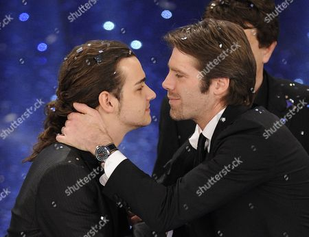 """Valerio Scanu is congratulated by Emanuele Filiberto after winning the """"Festival di Sanremo"""" Italian song contest at the Ariston theater in San Remo, Italy"""