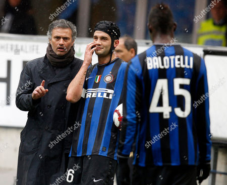 Inter Milan coach Jose Mourinho, of Portugal, left, talks to Romanian defender Cristian Chivu with Mario Balotelli at right, during a Serie A soccer match between Inter Milan and Bologna, at the San Siro stadium, in Milan, Italy