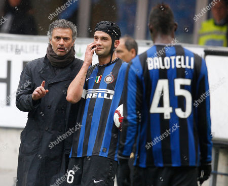 Inter Milan coach Jose Mourinho, of Portugal, left, talks to Romanian defender Cristian Chivu as Mario Balotelli looks, during a Serie A soccer match between Inter Milan and Bologna, at the San Siro stadium in Milan, Italy