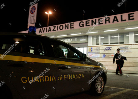 Stock Picture of An Italian Finance police car is parked outside Rome's Ciampino airport terminal, early, as Fastweb founder Silvio Scaglia is expected to arrive back in Italy for questioning. A wide-ranging investigation into an alleged ?2 billion ($2.7 billion) money-laundering ring involving two Italian Internet and phone companies has raised concerns about the stability of the Italian telecommunications industry