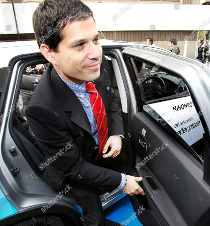 Shai Agassi California-based electric-vehicle services provider Better Place Chief Executive Shai Agassi gets off an electric vehicle taxi during the opening ceremony of a battery switch station in Tokyo, Japan, . Three electric cabs began a 90-day trial in Tokyo Monday that officials and the company involved say could eventually lead to the electrification of the city's entire taxi fleet. Better Place and Nihon Kotsu taxi company, Tokyo's biggest, are cooperating with the test-run of cabs that run on lithium-ion batteries that can be changed in less than one minute with fully charged ones at the station