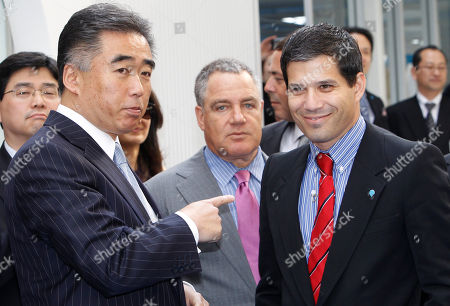 Shai Agassi, Idan Ofer, Kiyotaka Fujii California-based electric-vehicle services provider Better Place Chief Executive Shai Agassi, right, Better Place Chairman of the Board Idan Ofer, center, and Better Place Japan President Kiyotaka Fujii chat at the opening ceremony of a battery switch station for electric cabs in Tokyo, Japan, . Three electric cabs began a 90-day trial in Tokyo Monday that officials and the company involved say could eventually lead to the electrification of the city's entire taxi fleet. Better Place and Nihon Kotsu taxi company, Tokyo's biggest, are cooperating with the test-run of cabs that run on lithium-ion batteries that can be changed in less than one minute with fully charged ones at the station