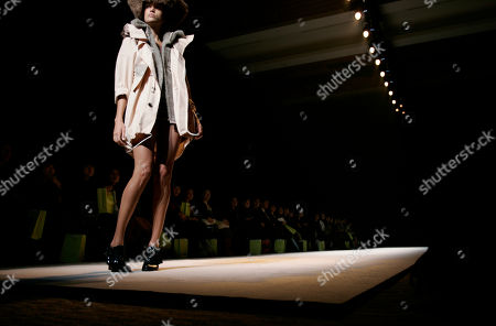 A model displays a creation by Kamishima Chinami in her 2010-2011 autumn/winter collection during the Japan Fashion Week in Tokyo, Japan