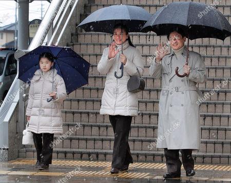 Aiko, Masako, Naruhito Japan's Crown Prince Naruhito, right, and Crown Princess Masako wave as they arrive with their daughter Princess Aiko, 8, at Nagano railway station in Nagano, central Japan, . The royal family visited a ski resort in the region on vacation