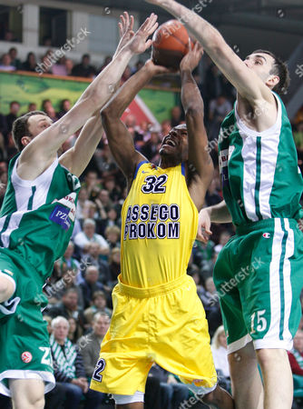Arturas Milaknis, left, and Mirza Begic,right, of Lithuania's BC Zalgiris vies for the ball with Daniel Ewing of Poland's BC Asseco Prokom during a Euroleague match in Kaunas, Lithuania