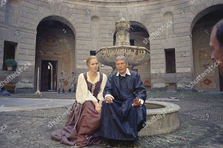 "Movie actress Liv Ullmann and Peter Finch sit on the movie set of ""Abdication"" in between scenes in Caprarola in Viterbo, Italy, Oct. 1973"