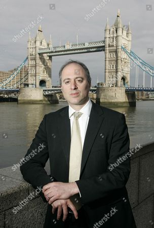 In this photo made, Andrew Altman, Chief Executive of the London Olympics Legacy Company, which is in charge of ensuring the post-games success of one of the biggest British regeneration projects in decades, gestures during an interview with The Associated Press at City Hall in London
