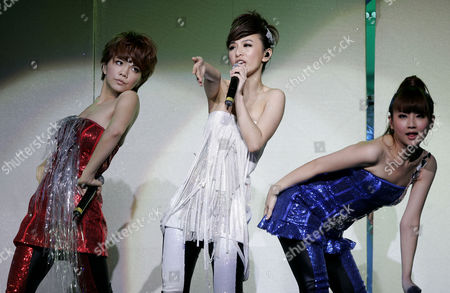 "Ella Chen, Hebe Tian, Selina Ren From left, Ella Chen, Hebe Tian and Selina Ren of the Taiwanese group ""S.H.E"" perform at their concert in Kuala Lumpur, Malaysia"