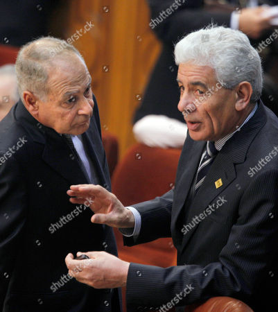 Libyan foreign minister Mousa Kousa, right, talks to his Egyptian counterpart Ahmed Abu el-Gheit during the Arab foreign ministers meeting at the Arab League headquarters in Cairo, Egypt, . U.S.-mediation for Middle East peace talks are on top of the agenda
