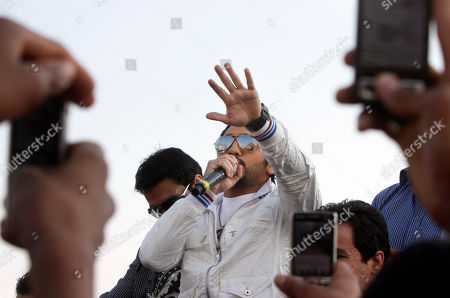 Fans film the famous Egyptian superstar Tamer Hosny as he performs during Orphan's Day in front of Giza Pyramid, Egypt