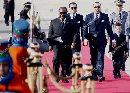 Ali Bongo Ondimba, Mohammed VI Morocco's King Mohammed VI, second right, welcomes Gabon President Ali Bongo Ondimba, left, at Tangiers airport, Morocco, . At left is Crown Prince Moulay El Hassan and at center behind is Prince Moulay Rachid King brother. Ali Bongo is on a tree-day official visit in Morocco