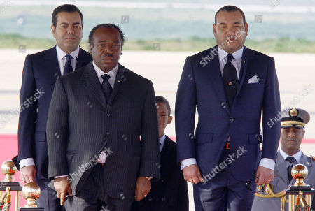 Ali Ben Bongo Ondimba, Mohammed VI Morocco's King Mohammed VI, right, with Gabonese President Ali Ben Bongo Ondimba, listen to national anthems at Tangiers airport, Morocco, . Behind at center is Crown Prince Moulay El Hassan and at behind at left is Prince Moulay Rachid, the King's brother. Ali Bongo is on a three-day official visit in Morocco
