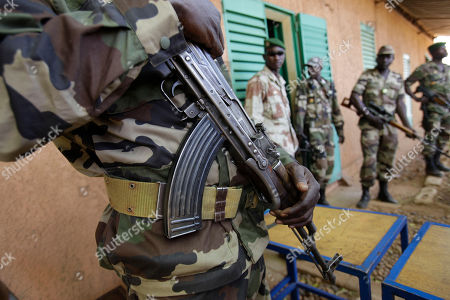Soldiers stand guard outside a room where Salou Djibo, leader of the military junta which overthrew the nation's strongman president days earlier, and junta members meet with envoys from the U.N., African Union., and ECOWAS at an army base in Niamey, Niger