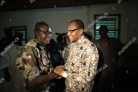 Salou Djibo, Mohammed Ibn Chambas Salou Djibo, left, leader of the military junta which overthrew the nation's strongman president days earlier, greets ECOWAS President Mohammed Ibn Chambas, as the ruling junta meets with envoys from the U.N., African Union., and ECOWAS, in central Niamey, Niger