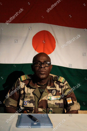 Salou Djibo Salou Djibo, leader of the military junta who overthrew Niger's strongman president days earlier, sits in front of a Niger flag as he prepares to meet with envoys from the U.N., African Union., and ECOWAS, at an army base in Niamey, Niger