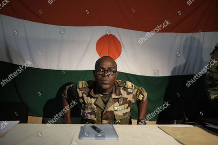 Salou Djibo Salou Djibo, leader of the military junta which overthrew Niger's strongman president days earlier, stands to welcome envoys from the U.N., African Union., and ECOWAS, as they meet with the ruling junta at an army base in Niamey, Niger