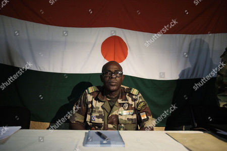 Salou Djibo Salou Djibo, leader of the military junta which overthrew the nation's strongman president days earlier, sits in front of a Niger flag as he prepares to meet with envoys from the U.N., African Union., and ECOWAS, in central Niamey, Niger