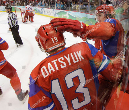 Russia's Pavel Datsyuk (13) celebrates with Sergei Fedorov after Evgeni Malkin scored in the first period of a men's preliminary round ice hockey game at the Vancouver 2010 Olympics in Vancouver, British Columbia