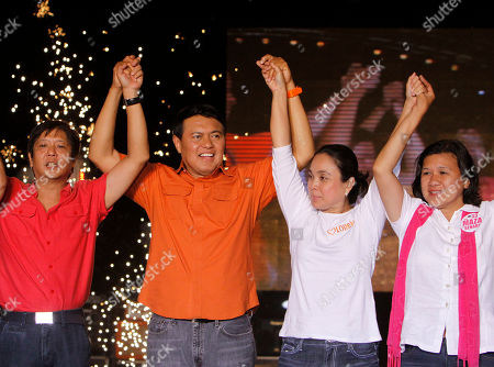 Presidential candidate Senator Manny Villar second left, raises his hands together with his vice presidential candidate Senator Loren Legarda second right, and senatorial candidates Ferdinand Marcos Jr. left and Lisa Maza during their major campaign sortie in Manila's urban poor area of Tondo, Philippines. Villar, considered to be the richest among the candidates have showed a poor ratings during the last survey where he slids down a few days before the May 10 elections