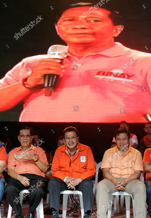 """JOSEPH ESTRADA Ousted Philippine leader and ex-movie action star Joseph Estrada, center, one of nine candidates for the May 10 presidential elections, listens beside, from left, senatorial candidates Juan Ponce Enrile and Estrada's son Jose Pimentel """"Jinggoy"""" as Vice-Presidential bet Jejomar BInay is projected on an electronic screen during a campaign rally in Makati city, south of Manila, Philippines late . Though some doubted Estrada's chances at the polls when he was overthrown by a nonviolent """"people power"""" revolt and subsequent plunder conviction, he surprised many when he landed second spot in a recent independent popularity survey of the nine candidates"""